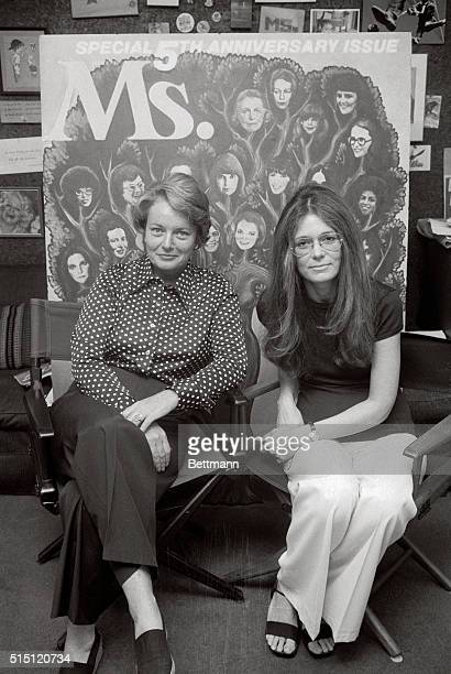 Patricia Carbine VP of Ms magazine and Gloria Steinem editor of Ms sit in front of a mockup of the cover of the fifth anniversary issue of the...