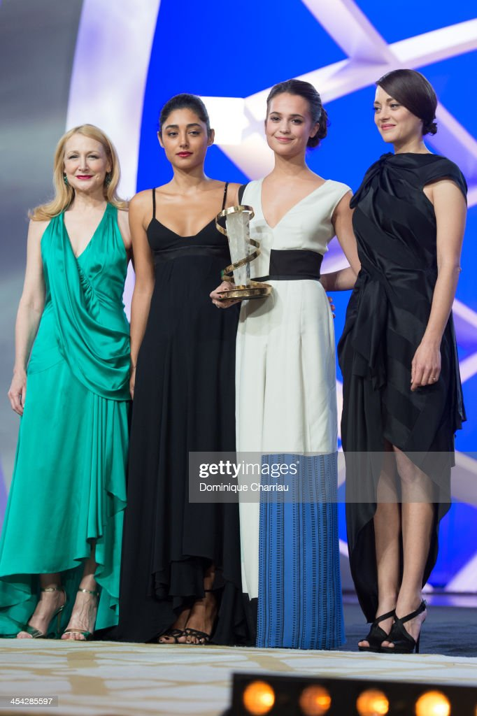 Patricia Clarkson, Golsshifteh Farhani and Marion Cotillard pose with Alica Vikander awarded Best actress during the Award Ceremony of the 13th Marrakech International Film Festival on December 7, 2013 in Marrakech, Morocco.