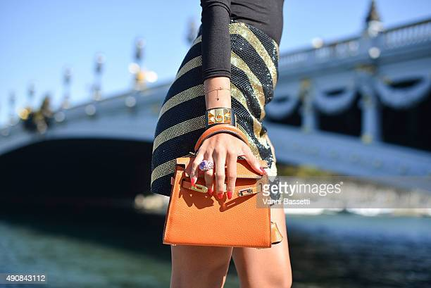 Patricia Contreras poses wearing a Balmain skirt and Hermes bag and bracelet after the Manish Arora show at the Alexander III bridge during Paris...