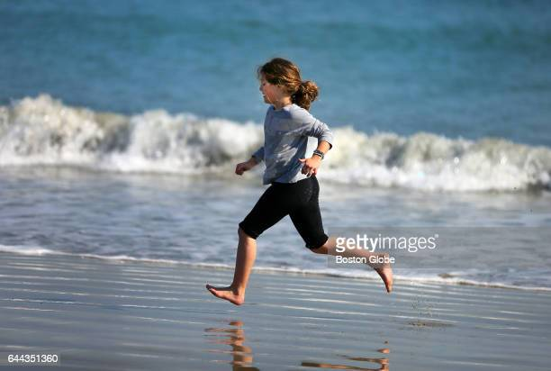 Patricia Davila from Chestnut Hill runs along the water edge at Revere Beach in Revere Mass on Feb 23 2017 The weather in the Boston was unseasonably...