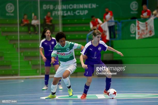 Patricia Gahm of SpVgg Greuther Fuerth challenges Paula Druschke of SGS Essen during the C Junior Girl's German Futsal Championship match between...