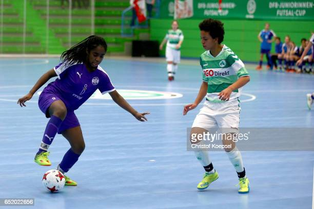 Patricia Gahm of SpVgg Greuther Fuerth challenges Shelbi Appiah of SGS Essen during the C Junior Girl's German Futsal Championship premilary match...