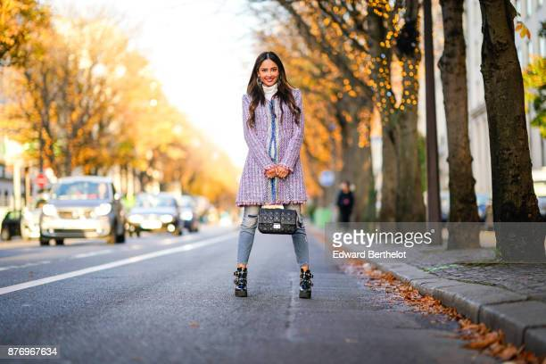 Patricia Gloria Contreras wears a Chanel tweed pink purple coat HM boots a Dior bag Dolce Gabbana blue denim jeans at avenue Montaigne on November 19...