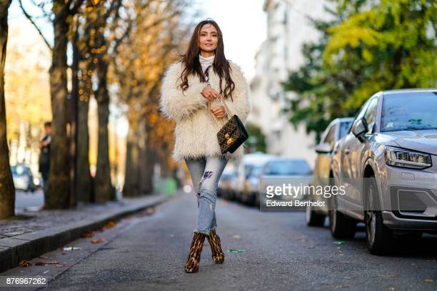 Patricia Gloria Contreras wears a white fur coat Dolce Gabbana blue denim jeans Jimmy Choo snake print leather shoes a Dior bag a white turtleneck...