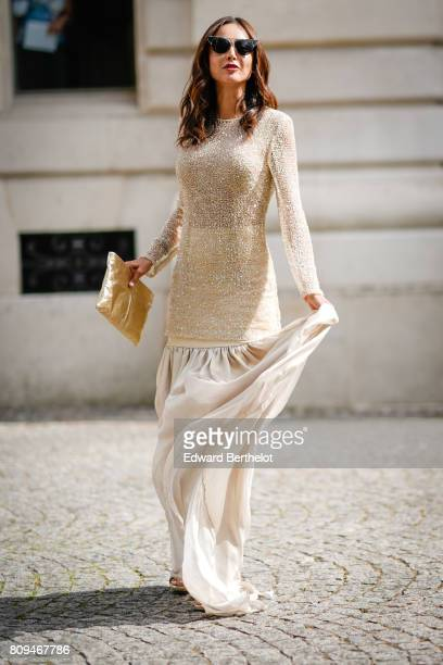 Patricia Gloria Contreras wears a white lace dress outside the Zuhair Murad show during Paris Fashion Week Haute Couture Fall/Winter 20172018 on July...