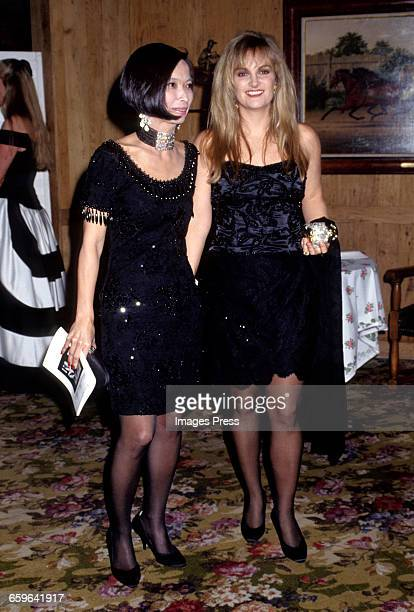 Patricia Hearst and guest attend Truman Capote's Black White Ball circa 1991 in New York City