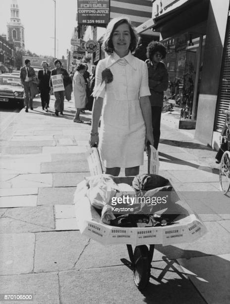 Patricia Hodgson the Conservative candidate for Islington South and Finsbury takes her £150 deposit in the form of a wheelbarrow full of coins to...