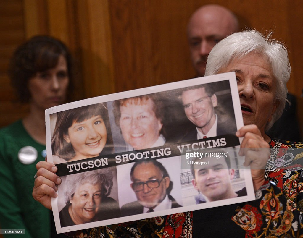 Patricia Maisch, who helped prevent the Tucson shooter from reloading, holds photos of the six victims as she speaks to media before testifying on a universal background check bill for private gun sales, March, 04, 2013, at the Colorado State Capitol.