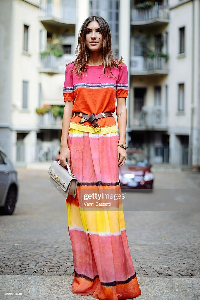 Patricia Manfield poses wearing an Alberta Ferretti dress and Pollini bag on September 17 2014 in Milan Italy