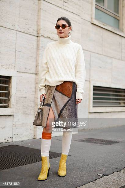 Patricia Manfield poses wearing Tommy Hilfiger sweater Missoni shoes and skirt and Fendi bag during day 2 of Milan Menswear Fashion Week Fall/Winter...