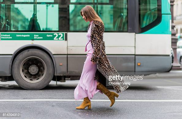 Patricia Manfield wearing a pink Stella McCartney dress and a coat with leopard print outside Stella McCartney during the Paris Fashion Week...