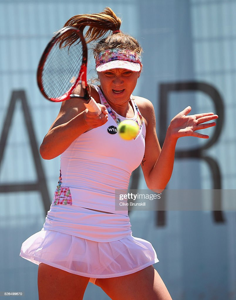 Patricia Maria Tig of Romania plays a forehand against Maria Sakkari of Greece in their second round qualifying match during day one of the Mutua Madrid Open tennis tournament at the Caja Magica on April 30, 2016 in Madrid, Spain. .