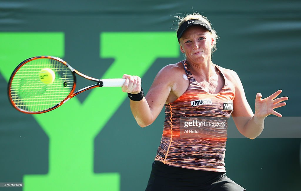 Patricia Mayr-Achleitner of Austria returns a shot to Sara Errani of italy during their match on day 4 of the Sony Open at Crandon Park Tennis Center on March 20, 2014 in Key Biscayne, Florida.