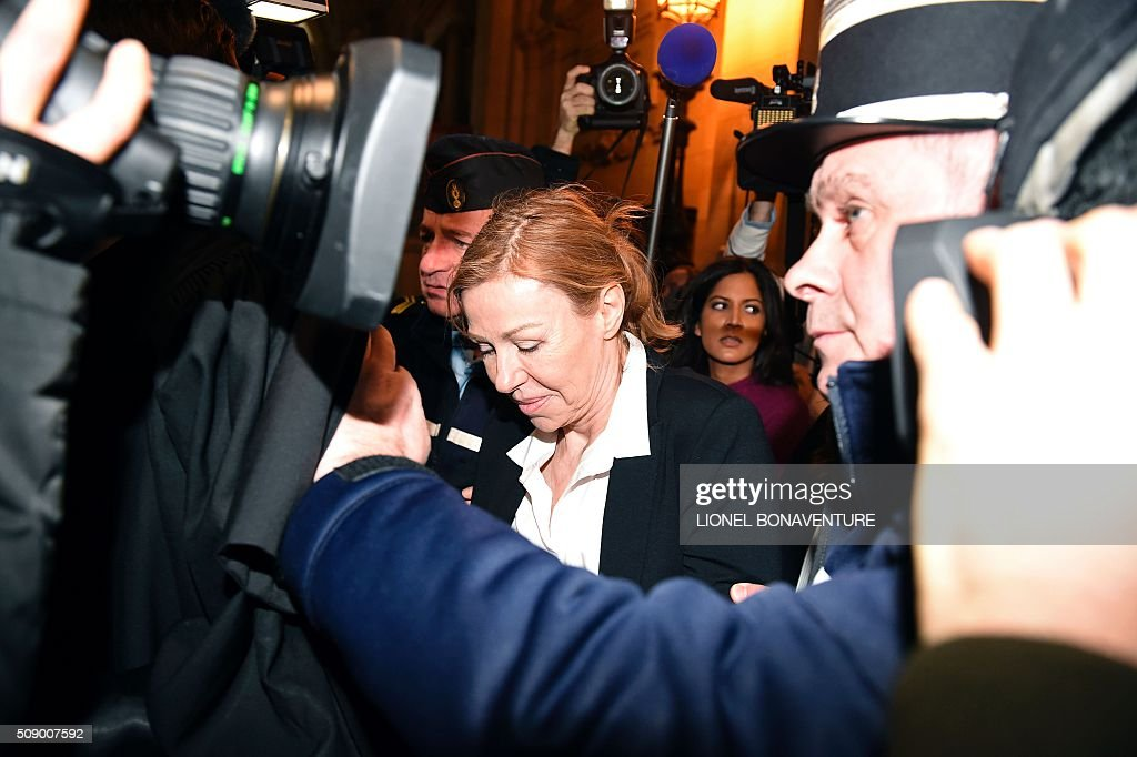 Patricia Menard, ex-wife of former French budget minister Jerome Cahuzac, arrives on the first day their trial for tax fraud at the courthouse of Paris, on February 8, 2016. Cahuzac, 63, who resigned in disgrace in 2013 after admitting to having a secret Swiss bank account, faces up to seven years in jail and two million euros (USD 2.2 million) in fines if found guilty of stashing offshore his earnings from a lucrative hair-transplant business he ran with his now ex-wife. AFP PHOTO / LIONEL BONAVENTURE / AFP / LIONEL BONAVENTURE