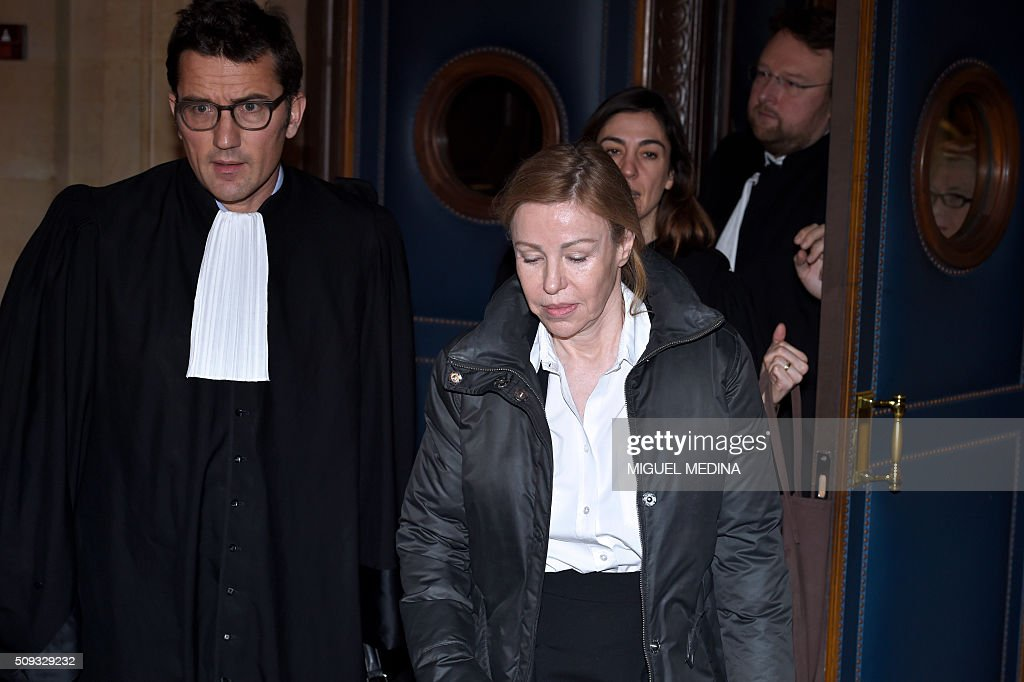 Patricia Menard, the ex-wife of France's former budget minister, Patricia Menard leaves the Paris courthouse after her fraud trial was adjourned to a later date on a technical legal question, on its second day on February 10, 2016. France's former budget minister Jerome Cahuzac, who stashed millions abroad while cracking down on tax cheats at home, went on trial on February 9 for tax fraud and money laundering. His trial was adjourned to September 5, 2016 after his lawyers argued that Cahuzac has already settled his debts with the tax authorities and should not be tried twice over the same matter. / AFP / MIGUEL MEDINA