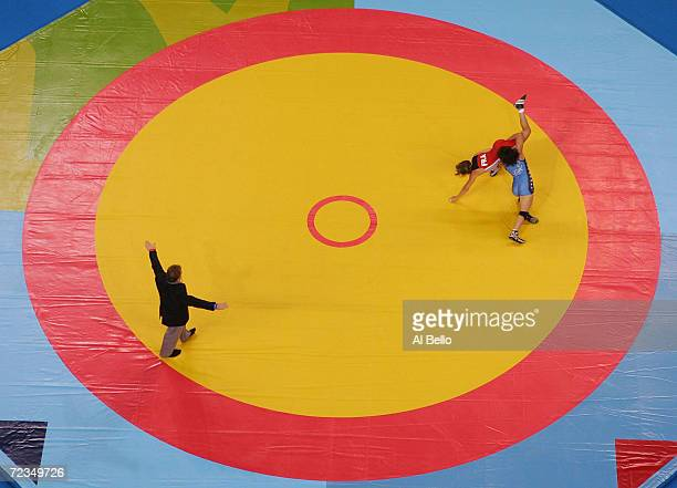 Patricia Miranda of the USA and Angelique Berthenet of France compete during the women's Freestyle wrestling 48 kg bronze medal match on August 23...