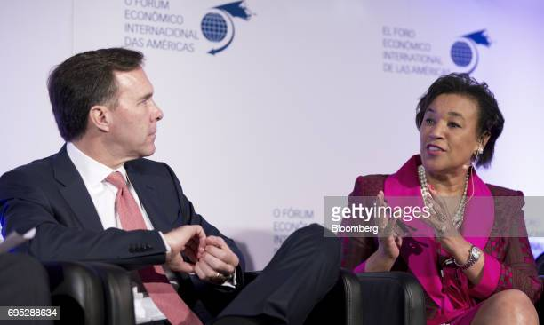 Patricia Scotland secretary general of the Commonwealth of Nations right speaks as Bill Morneau Canada's finance minister listens during a panel...
