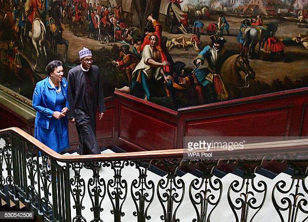 Patricia Scotland secretarygeneral of the Commonwealth speaks with Nigerian President Muhammadu Buhari on arrival at Marlborough house prior to the...
