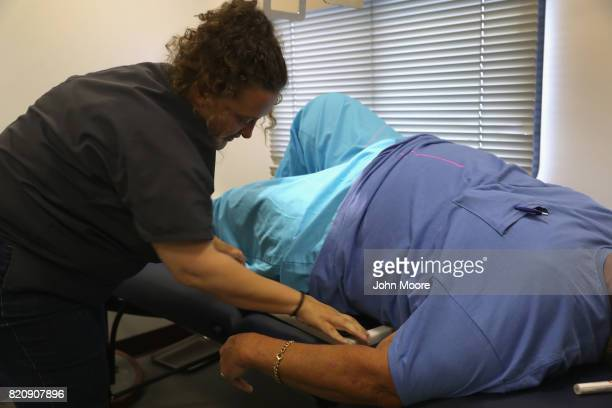 Patricia Sonner from Mobile Images prepares to perform an Xray at a free health clinic on July 22 2017 in Wise Virginia Hundreds of Appalachia...