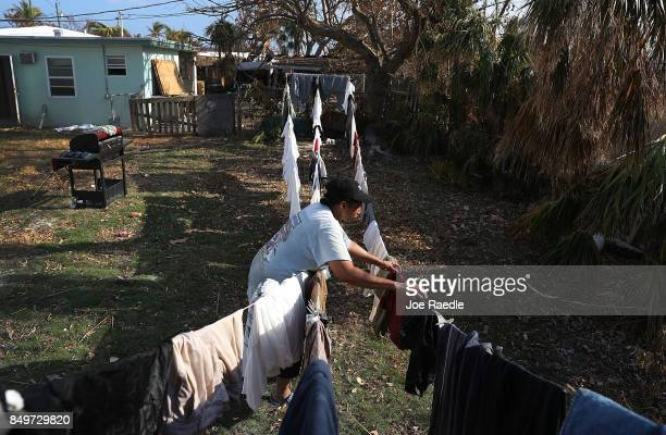Patricia Spencer hangs up laundry as she tries to salvage what she can from her home after it was damaged by hurricane Irma on September 19 2017 in...