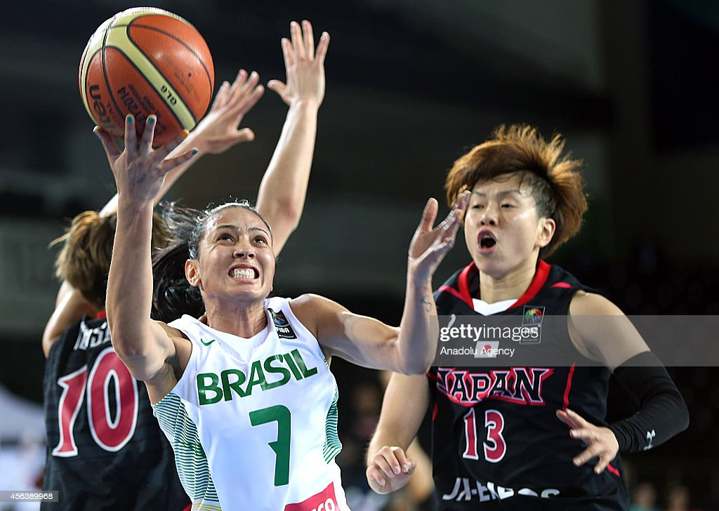 Patricia Teixeira of Brazil in action against Ramu Tokashiki and Yuko Oga of Japan during the 2014 FIBA World Championship For Women Group A...