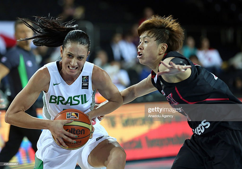 Patricia Teixeira of Brazil in action against Yuko Oga of Japan during the 2014 FIBA World Championship For Women Group A basketball match between...