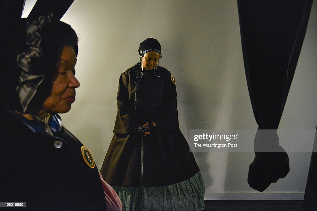 Patricia Tyson, L, and Kawther Elim, who are Female Re-Enactors of Distinction for the African-American Civil War Museum, listen to speeches honoring the late Frederick Douglass as the National Park Service and the Frederick Douglass National Historic Site observe the 196th birthday of Frederick Douglass on Saturday, February 8, 2014, in Washington, DC. Born a slave in Maryland in 1818, Douglass gained his freedom and rose to become an important human rights activist, an key abolitionist, and a powerful orator, author, and journalist.