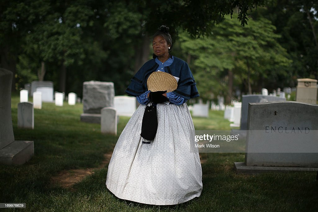 Patricia Tyson of the African American Civil War Museum in Washington, attends a wreath laying ceremony at the gravesite of Buffalo Soldier Col. Charles Young, at Arlington Cemetery, June 5, 2013 in Arlington, Virginia. The event was hosted by the National Coalition of Black Veterans and the Omega Psi Phi Fraternity to celebrate the 90th anniversary of 'Buffalo Soldier' and military leader Col. Charles Young's internment in Arlington Cemetery.