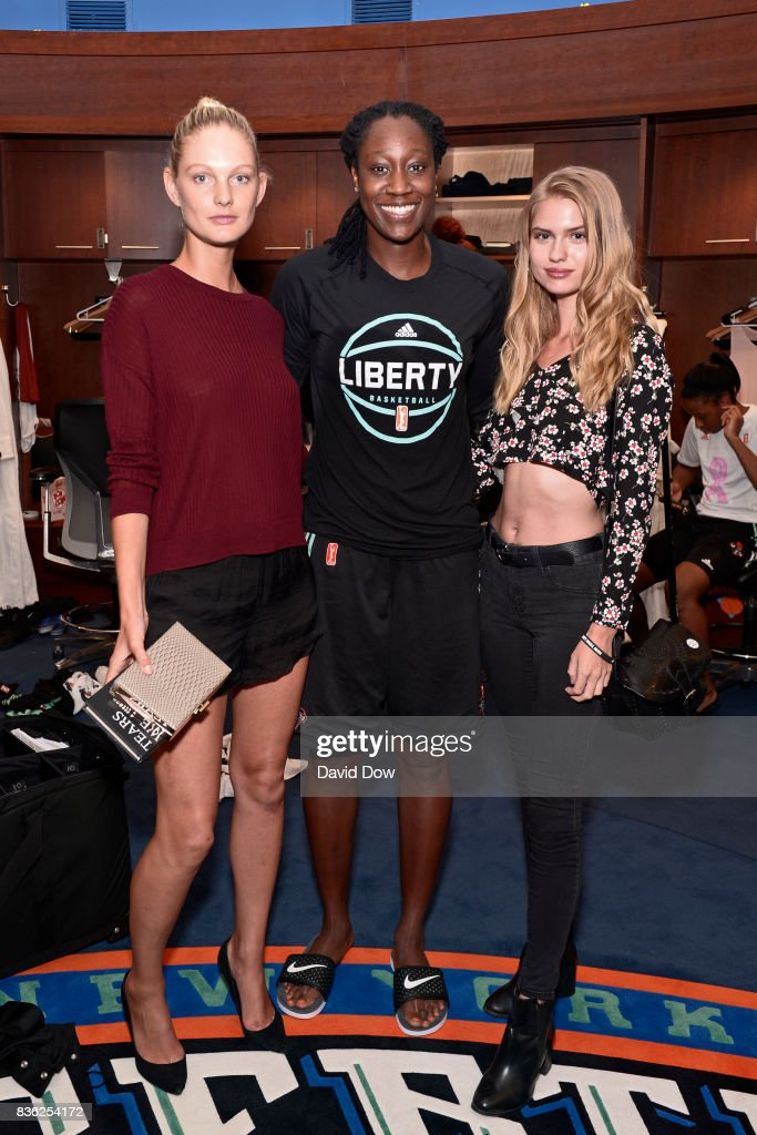 Patricia Van Der Vliet and Chelsey Weimar pose with Tina Charles #31 of the New York Liberty after the game against the Minnesota Lynx on August 20, 2017 at the Madison Square Garden in New York City, New York.