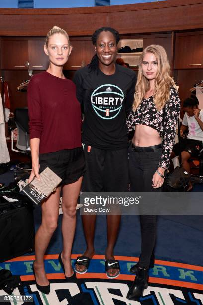 Patricia Van Der Vliet and Chelsey Weimar pose with Tina Charles of the New York Liberty after the game against the Minnesota Lynx on August 20 2017...