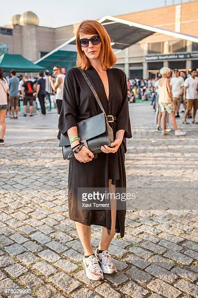 Patricia wears American Apparel dress Zara bag Nike trainers and Dasoon sunglasses during Sonar Music Festival on June 20 2015 in Barcelona Spain