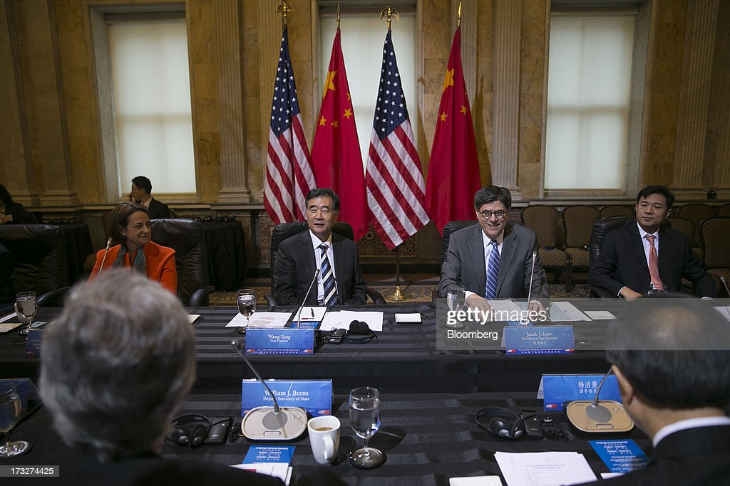 Patricia Woertz, chairman, president and chief executive officer of Archer-Daniels-Midland Co., left to right, Wang Yang, China's vice premier, Jacob 'Jack' Lew, U.S. treasury secretary, and Robin Li, chief executive officer of Baidu Inc., attend a chief executive officer roundtable with U.S. and Chinese business leaders during the U.S.-China Strategic and Economic Dialogue (S&ED) conference at the Treasury Department in Washington, D.C., U.S., on Thursday, July 11, 2013. The U.S. and China are meeting this week to find ways to balance a wider flow of investment and goods as their central banks try to prevent excessive risk-taking from derailing the world's biggest economies. Photographer: Andrew Harrer/Bloomberg via Getty Images
