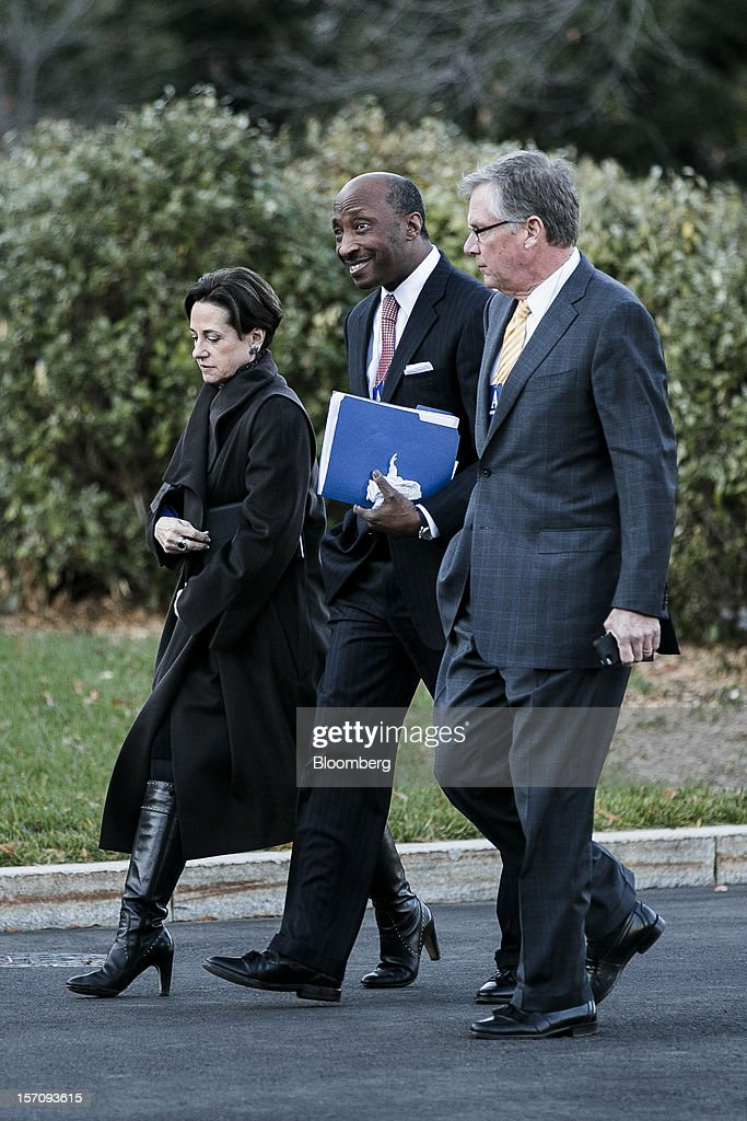 Patricia Woertz, chairman, president and chief executive officer of Archer Daniels Midland Co., from left, Kenneth Frazier, chief executive officer Merck & Co., and Douglas Oberhelman, chairman and chief executive officer of Caterpillar Inc., walk to the White House for a meeting with U.S. President Barack Obama in Washington, D.C., U.S., on Wednesday, Nov. 28, 2012. Business executives pressing for a solution to the so-called fiscal cliff made their case at the White House and the Capitol a day after Senate Majority Leader Harry Reid lamented the lack of progress toward a deal. Photographer: T.J. Kirkpatrick/Bloomberg via Getty Images