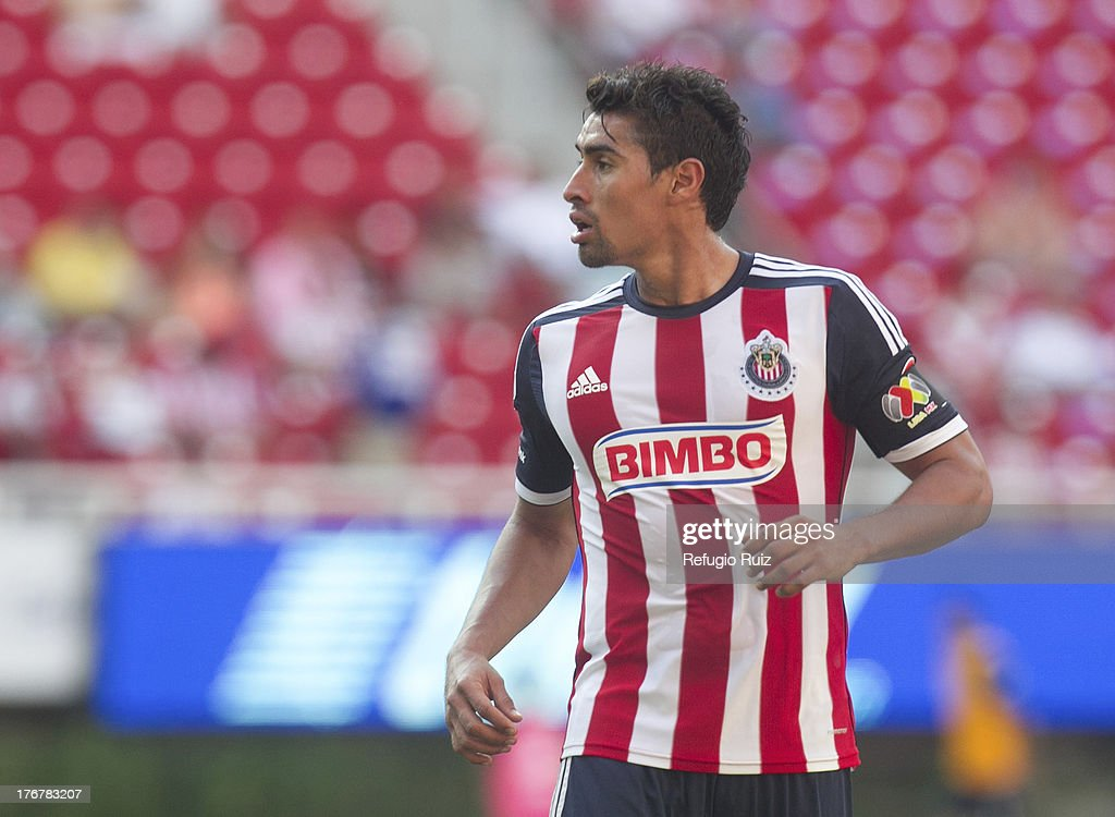 <a gi-track='captionPersonalityLinkClicked' href=/galleries/search?phrase=Patricio+Araujo&family=editorial&specificpeople=684725 ng-click='$event.stopPropagation()'>Patricio Araujo</a> of Chivas during a match between Chivas and Puebla as part of the Torneo Apertura Liga MX at the Omnilife Stadium on August 18, 2013 in Guadalajara, Mexico.