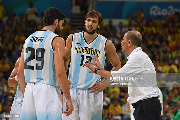 Patricio Garino Marcos Nicolas Delia and head coach Sergio Hernandez of Argentina talk during the game against Brazil on Day 8 of the Rio 2016...