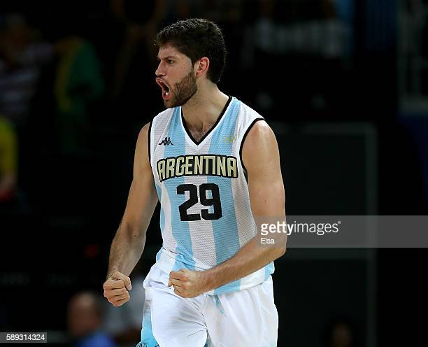 Patricio Garino of Argentina celebrates his shot in the second half against Brazil during the Men's Preliminary Round Group B match on day 8 of the...