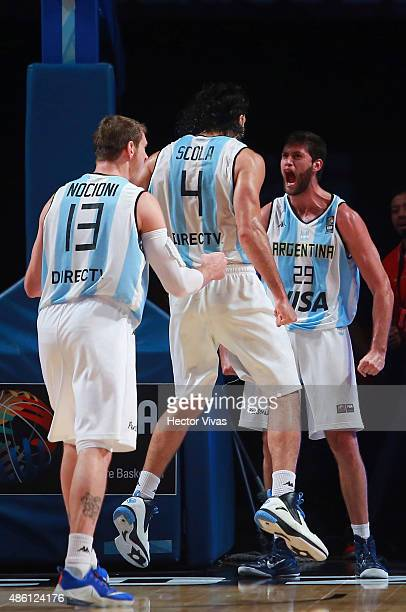 Patricio Garino of Argentina celebrates with Luis Scole and Andres Nocioni during a match between Argentina and Puerto Rico as part of the 2015 FIBA...