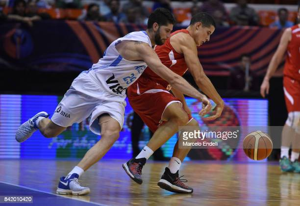 Patricio Garino of Argentina fights for ball with Francisco Cruz of Mexico during a semi final match between Argentina and Mexico as part of FIBA...