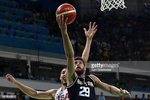 Patricio Garino of Argentina shoots the ball over Klay Thompson of United States during the Men's Quarterfinal match on Day 12 of the Rio 2016...