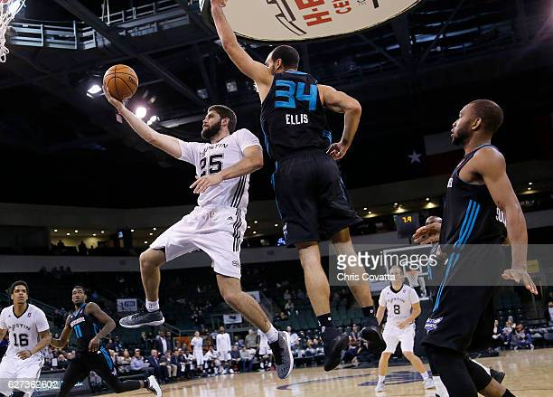 Patricio Garino of the Austin Spurs drives to the basket around Perry Ellis of the Greensboro Swarm at the HEB Center At Cedar Park on December 2...