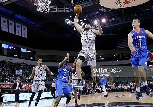 Patricio Garino of the Austin Spurs leaps to the basket past Daniel Hamilton of the Oklahoma City Blue at the HEB Center At Cedar Park on November 13...