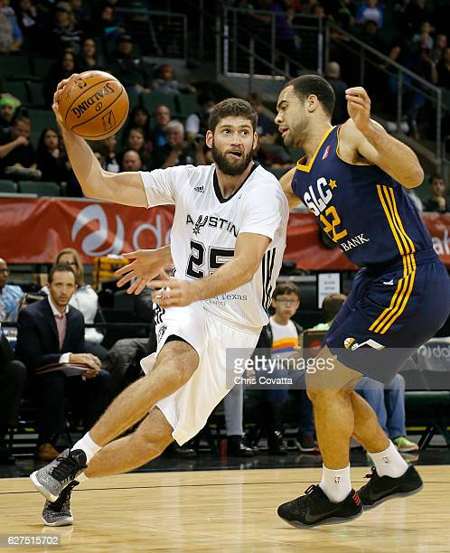 Patricio Garino of the Austin Spurs moves with the ball around JJ O'Brien of the Salt Lake City Stars at the HEB Center At Cedar Park on December 3...