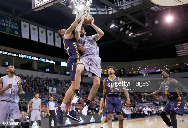 Patricio Garino of the Austin Spurs shoots the ball against Joel Bolomboy of the Salt Lake City Stars at the HEB Center At Cedar Park on March 5 2017...