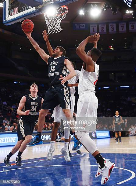 Patricio Garino of the George Washington Colonials drives to the hoop against the San Diego State Aztecs during their NIT Championship Semifinal game...