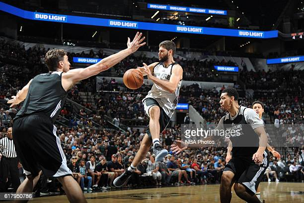 Patricio Garino of the San Antionio Spurs drives to the basket and passes the ball during an open scrimmage on October 18 2016 at the ATT Center in...
