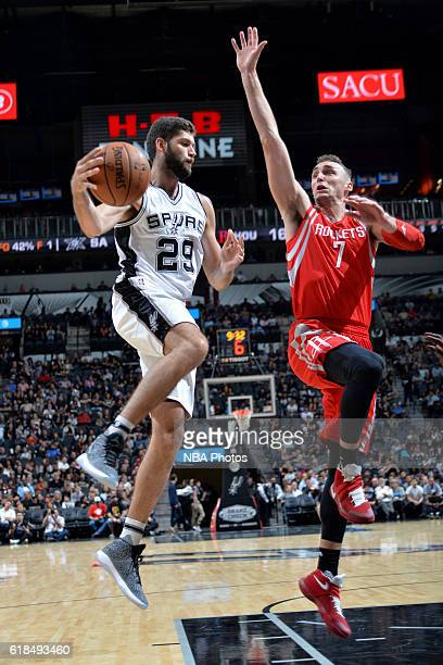 Patricio Garino of the San Antonio Spurs handles the ball against Sam Dekker of the Houston Rockets during a preseason game on October 21 2016 at the...