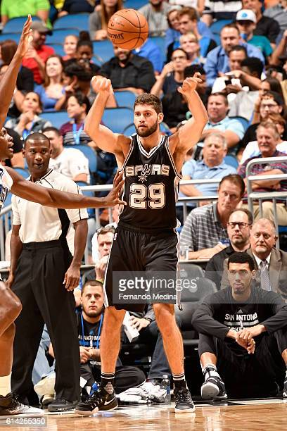 Patricio Garino of the San Antonio Spurs passes the ball against the Orlando Magic on October 12 2016 at the Amway Center in Orlando Florida NOTE TO...