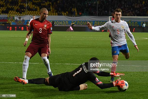 Patricio Pepe of Portugal and Mamaev of Russia contest the ball during the friendly match between Russia and Portugal at Kuban Stadium in Krasnodar...