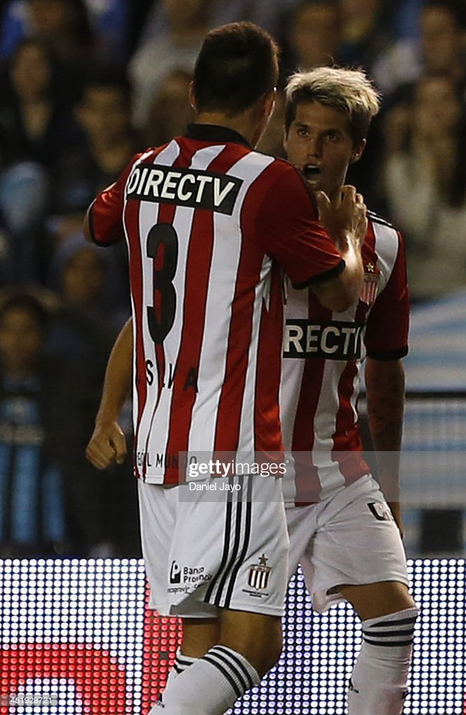 Patricio Rodriguez of Estudiantes (L) celebrates after scoring the third goal of his team during a match between Racing Club and Estudiantes as part of 11th round of Torneo Final 2014 at Presidente Peron Stadium on April 1, 2014 in Buenos Aires, Argentina.
