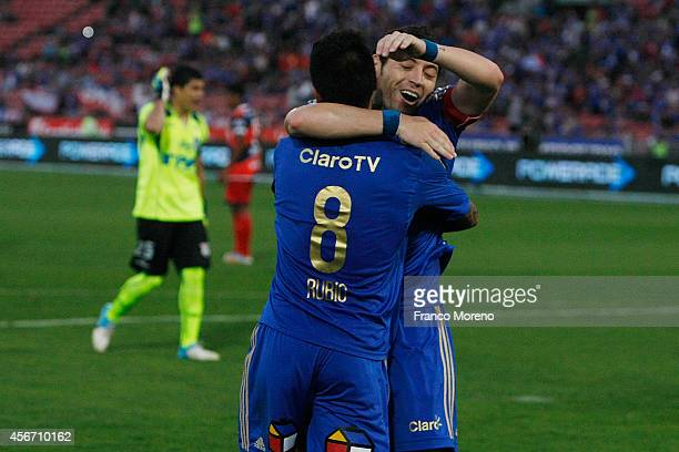 Patricio Rubio of Universidad de Chile celebrates with his teammate after scoring the second goal of his team during a match between U de Chile and...